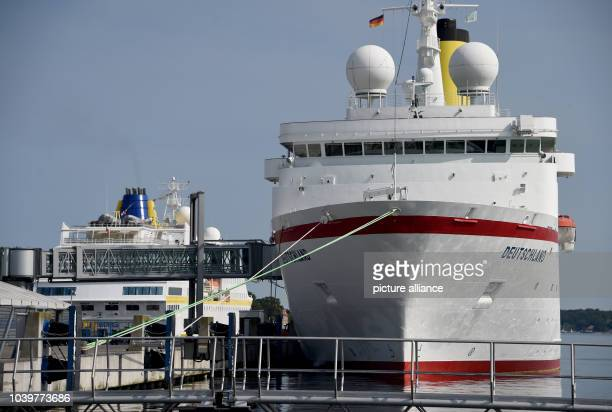 The cruise ship MSDeutschland is seen next to the MSHamburg at the Baltic Sea wharf in Kiel Germany 10 August 2015 The German television show 'Das...