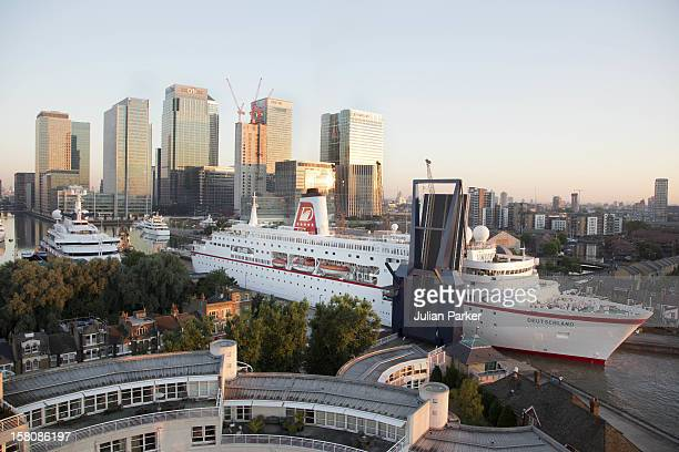 The Cruise Ship Ms Deutschland Is Edged Backwards Into West India Dock By Canary Wharf Early This Morning To Join Other Super Yachts Moored For The...