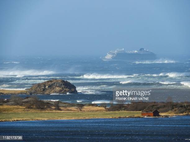 TOPSHOT The cruise ship Viking Sky is pictured on March 23 2019 near the west coast of Norway at Hustadvika near Romsdal Emergency services said on...