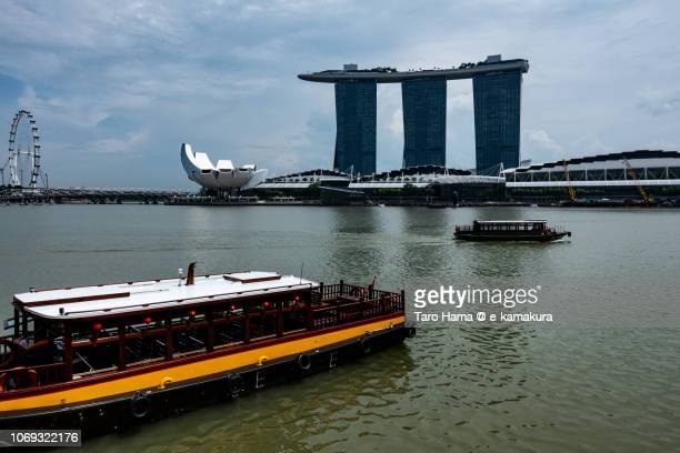 The cruising boats on Marina Bay and Marina Bay Sands in Singapore