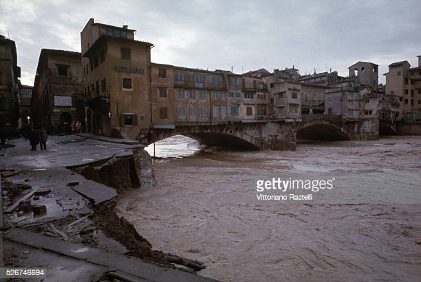 The crumbling exterior of the Ponte Vecchio in Florence following the devastating flood of November 1966 during which the water of the Arno rose as...