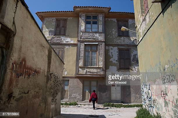 The crumbling facade of a period building on March 28 2016 in Mytilene GreeceConcerns over the economy on the island of Lesbos have grown as tourist...