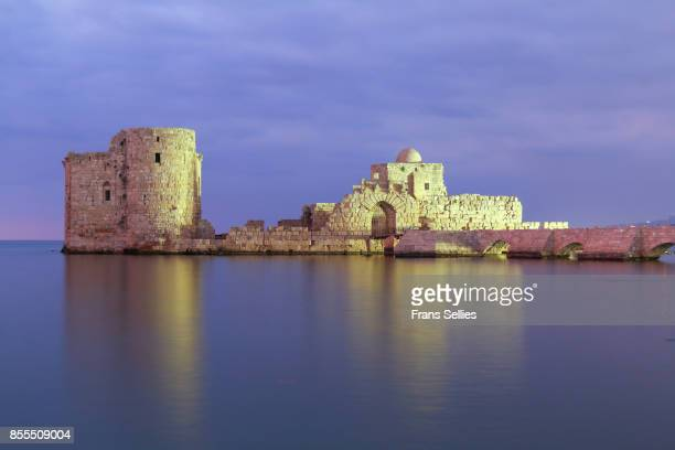 the crusader sea castle in sidon (saïda), illuminated in the evening, lebanon - lebanon stock photos and pictures