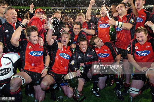 The Crusaders celebrate with the Super 12 trophy after the 3525 defeat of the Waratahs in the rugby final at Jade Stadium, Christchurch, New Zealand,...