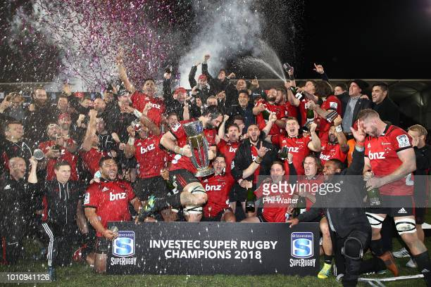 The Crusaders celebrate with the Super Rugby Trophy following the Super Rugby Final match between the Crusaders and the Lions at AMI Stadium on...
