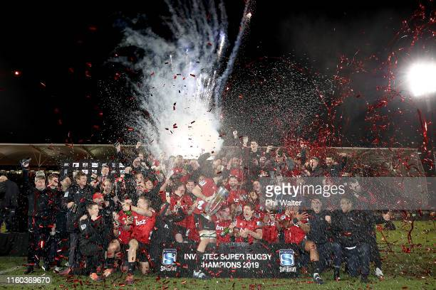 The Crusaders celebrate with the Super Rugby Trophy following the Super Rugby Final between the Crusaders and the Jaguares at Orangetheory Stadium on...