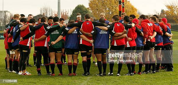 The Crusaders enter a huddle at the end of a training session at Rugby Park May 25 2006 in Christchurch New Zealand The Crusaders play the Hurricanes...