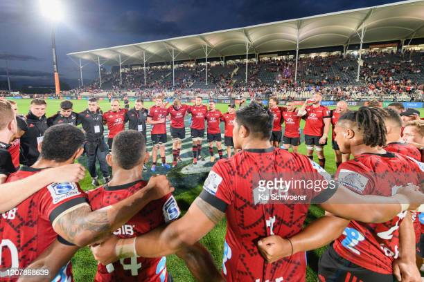 The Crusaders huddle after their win in the round four Super Rugby match between the Crusaders and Highlanders at Orangetheory Stadium on February 21...