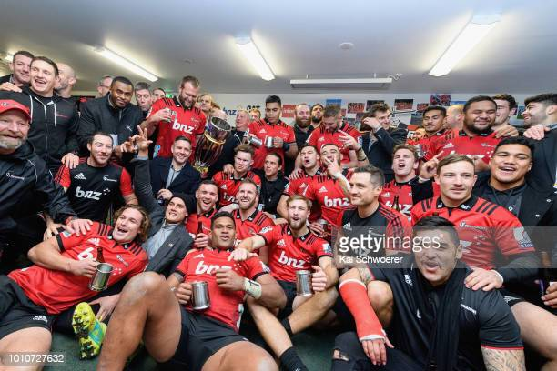 The Crusaders pose with the Super Rugby Trophy in their dressing room after their win in the Super Rugby Final match between the Crusaders and the...