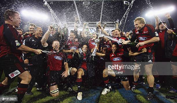 The Crusaders spray champagne as they celebrate their win over the Waratahs in the Super 14 final at AMI Stadium on May 31 2008 in Christchurch New...