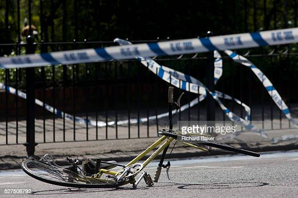 The crushed wreckage of a ladies bike lies on the surface of the A3 Kennington Park Road at the junction with A23 Kennington Road south London A...