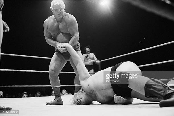 The Crusher wrestles Bobby Duncan to the floor in a tag team wrestling match at the International Amphitheatre 6/25 Duncan's partner Blackjack Lanza...