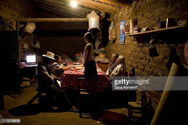 The Cruz family eat dinner in their kitchen on February 20, 2008 in the small town of San Marcos Tlapazola in Tlacolula. The mother, Rafaela,...