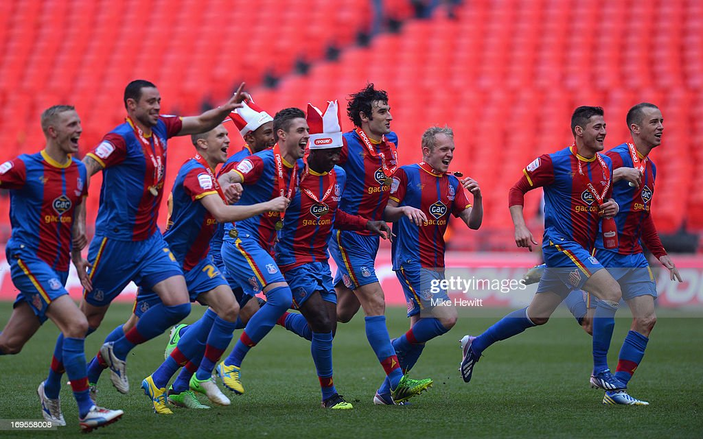 The Crystal Palace players celebrate following their victory in extra-time during the npower Championship Play-off Final match between Watford and Crystal Palace at Wembley Stadium on May 27, 2013 in London, England.