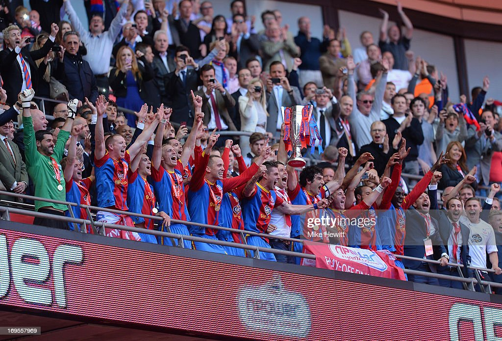The Crystal Palace players celebrate with the trophy following their victory in extra-time during the npower Championship Play-off Final match between Watford and Crystal Palace at Wembley Stadium on May 27, 2013 in London, England.