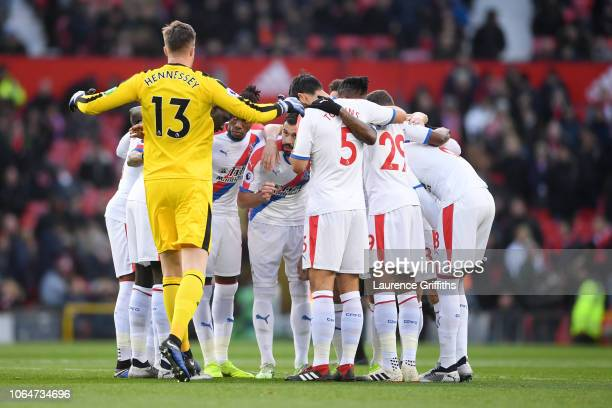 The Crystal Palace players form a team huddle prior to the Premier League match between Manchester United and Crystal Palace at Old Trafford on...