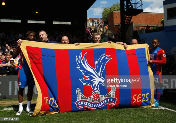 The Crystal Palace players pose with a Crystal Palace flag after the Premier League match between Crystal Palace and Hull City at Selhurst Park on...