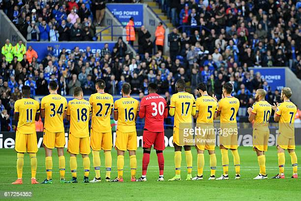 The Crystal Palace team take part in the minute's applause for the king of Thailand Bhumibol Adulyadej during the Premier League match between...