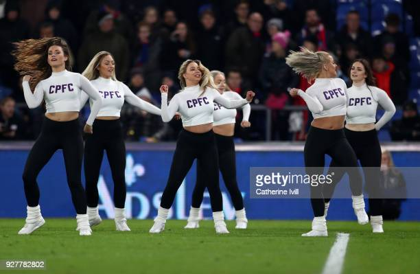 The Crystals cheerleaders perform during the Premier League match between Crystal Palace and Manchester United at Selhurst Park on March 5 2018 in...