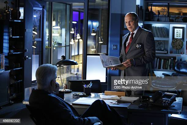 "The CSI Effect"" -- Conrad Ecklie looks over some files while in D.B. Russell's office but the two men have to come together quickly to deal with a..."