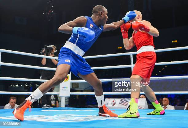 The Cuban boxer Erislandy Savon fights against the Kazakh boxer Vassiliy Levit in the heavy weight class during the Ameteur's Boxing World...