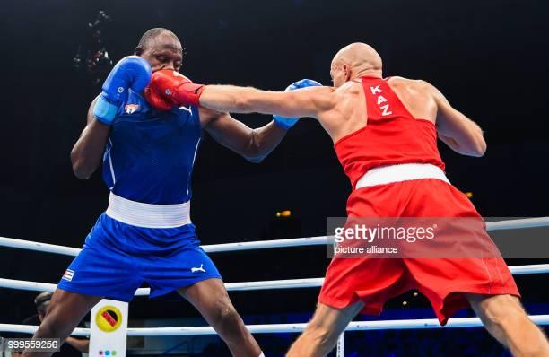 The Cuban boxer Erislandy Savon fights against the Kazakh boxer Vassili Levit in the half heavyweight class during the Ameteur's Boxing World...