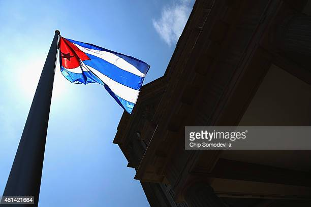 The Cuban flag flies in front of the country's embassy for the first time in 54 years July 20 2015 in Washington DC The embassy was closed in 1961...