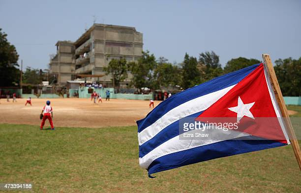The Cuban flag flies in the outfield as kids play baseball on May 09 2015 in the Alamar subarb of Havana Cuba