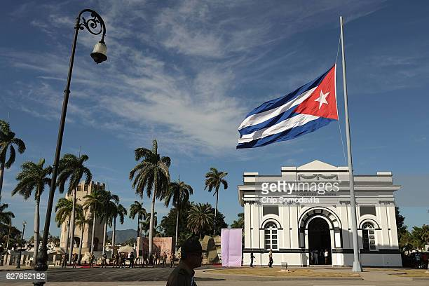 The Cuban flag flys at half staff after the remains of former Cuban President Fidel Castro arrived in the Cementerio Santa Ifigenia where he will be...