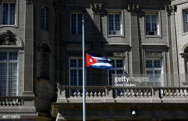 The Cuban flag waves outside of the Embassy of Cuba in Washington DC on October 3 2017 in Washington DC The US orders on Tuesday the expulsion of 15...