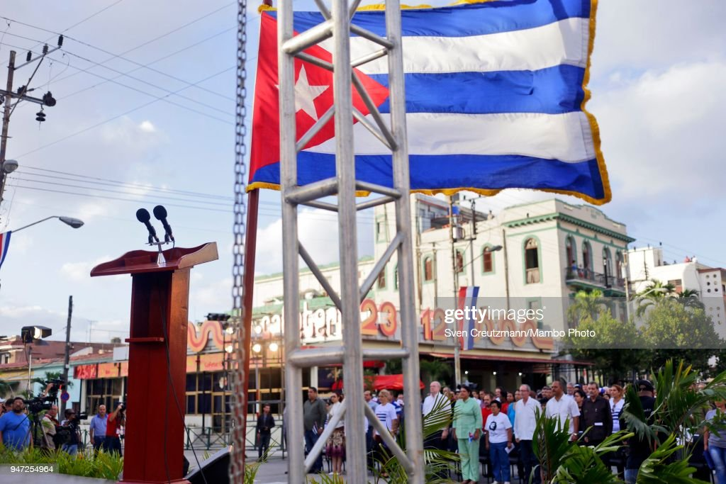 The Cuban flag waves over microphones during a political act commemorating the 57th anniversary of a speech in which Fidel Castro declared the revolution to be Socialistic, on April 16, 2018 in Havana, Cuba. The act took place at the same corner of the streets 23 and 12 in Havanas Vedado district, where Castro in 1961 attended a funeral rally after the bombing of Cuban airports that marked the begin of the Bay of Pigs invasion.