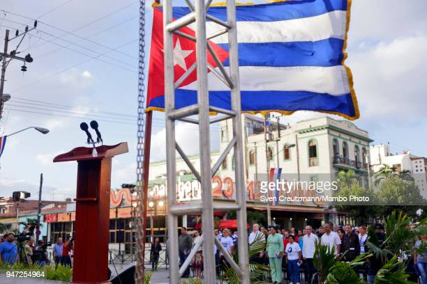 The Cuban flag waves over microphones during a political act commemorating the 57th anniversary of a speech in which Fidel Castro declared the...