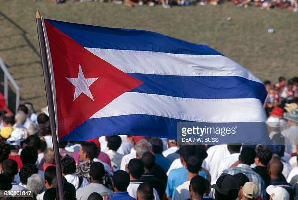 The Cuban flag waving in Revolution Square during the International Workers' Day event Cuba