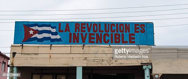 The Cuban Revolution is undefeatable Revolutionary propaganda poster at the top of old building