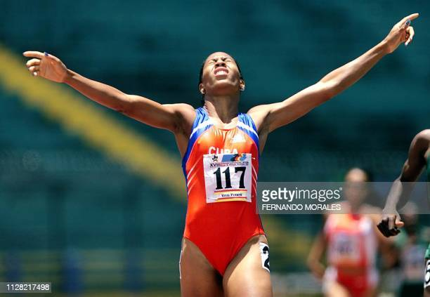 The Cuban runner Yanelis Lara celebrates as she passes the finish line and gets the gold metal for the 800 meters at the Central American and Greater...