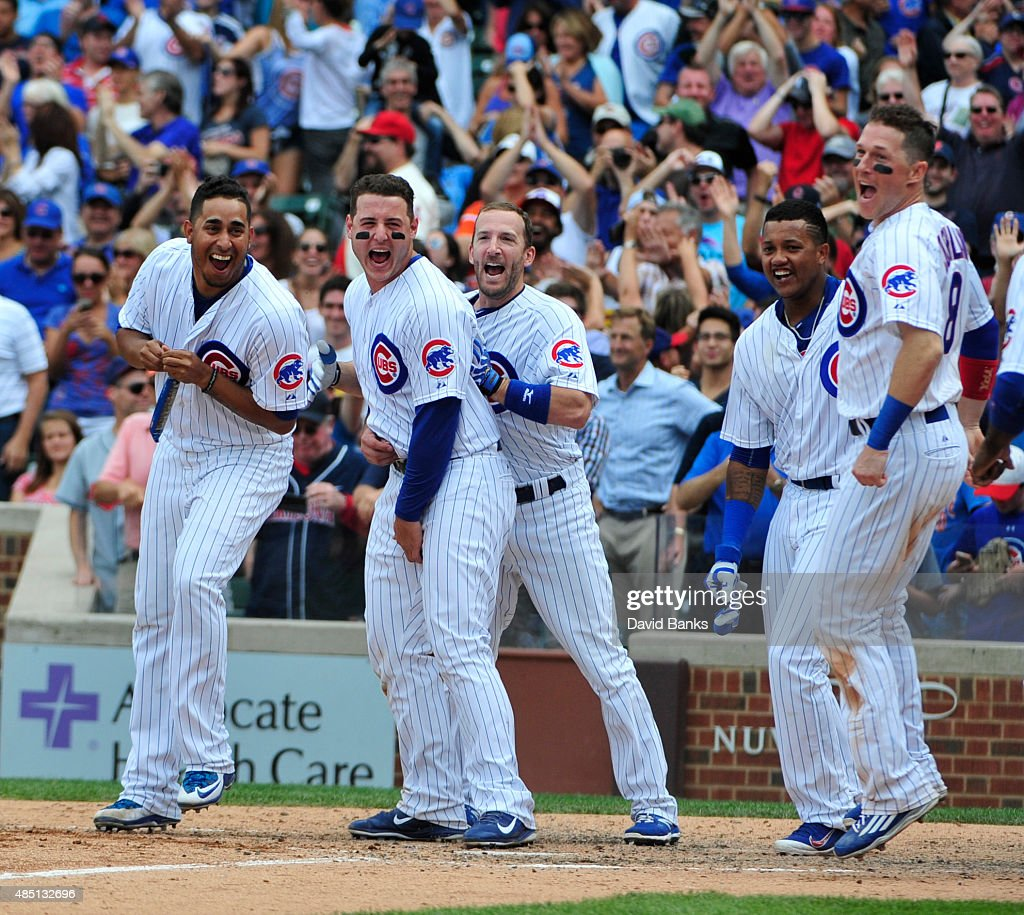 The Cubs celebrate Kris Bryant #17 of the Chicago Cubs walk-off home run against the Cleveland Indians during the ninth inning on August 24, 2015 at Wrigley Field in Chicago, Illinois. The Cubs won 2-1.