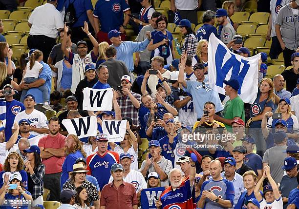 The Cubs fans break out their 'W' banners to celebrate the victory during game five of the National League Championship Series between the Chicago...