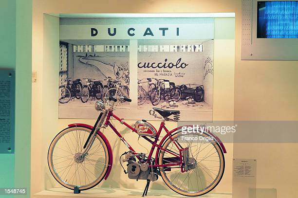 The 'Cucciolo' or puppy a hybrid between a bike and a scooter produced in 1936 sits in the Ducati Museum September 13 2002 in Borgo Panigale Bologna...