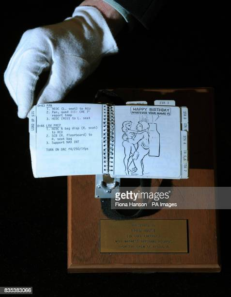 The cuff mounted checklist worn by astronaut Charles Duke during the Apollo 16 mission on the surface of the moon estimated at $200000 to $300 at...