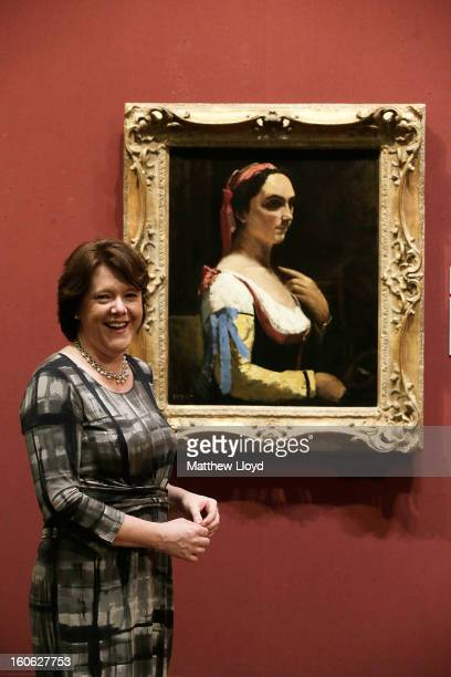 The Culture Secretary Maria Miller poses for photographs in front of 'L'Italienne ou La Femme a la Manche Jaune' by French artist Jean-Baptiste...