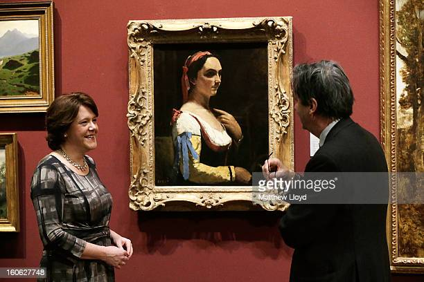 The Culture Secretary Maria Miller talks to Dr Nicholas Penny, Director of the National Gallery in front of 'L'Italienne ou La Femme a la Manche...