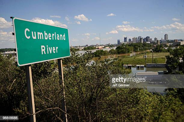 The Cumberland River floods outside of its rivers banks Tuesday on May 4 2010 in Nashville Tennessee More than 13 inches of rain fell over two days...