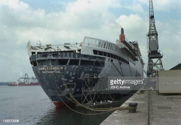 The Cunard liner QE2 being refitted as a troopship at Southampton during the Falklands War April 1982