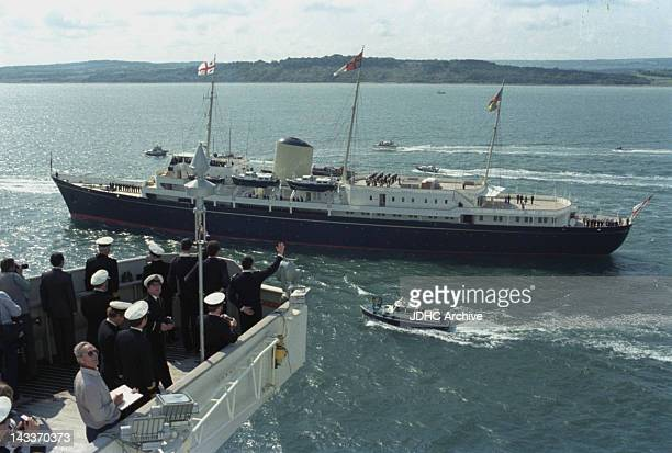 The Cunard liner 'RMS Queen Elizabeth 2' is met by the Royal Yacht 'Britannia' upon her return to Southampton having been requisitioned as a British...