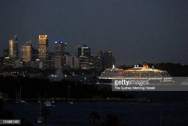 The Cunard passenger liner Queen Victoria moves down Sydney Harbour before docking at the International Passenger Terminal at Circular Quay at dawn...