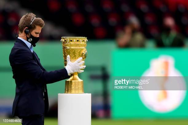 The Cup is placed on a podium before the start of the German Cup final football match Bayer 04 Leverkusen v FC Bayern Munich at the Olympic Stadium...