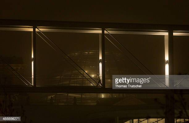 The cupola of the Reichstag building behind a small bridge on a foggy night on December 12 2013 in Berlin Germany The cupola was added to the...