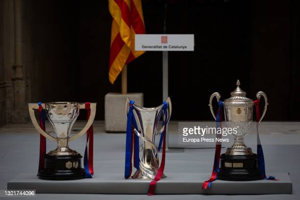 The cups won by the FC Barcelona women's team in the Iberdrola Primera, the Champions League and the Copa de la Reina, at the Palau de la...