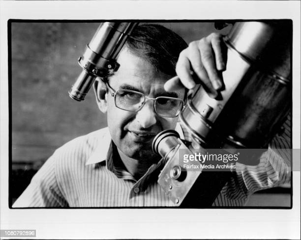 The Curator of Astronomy at the Sydney Observatory Dr Nick Lomb seen here with the original telescope at the observatory October 12 1988