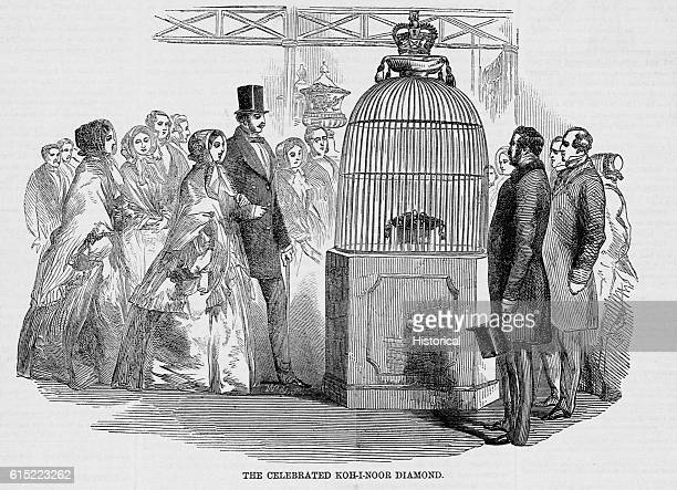 The curious inspect the KohINoor diamond while it is on display at the World's Fair in London The stone rests inside a chamber filled with gas to...